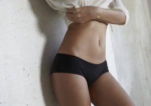 Close Up of Female's Flat Stomach in Black Panties